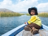 17 An Uro boy being transported on a boat across the Lake Titicaca, courtesy Christopher Crouzet and Wikimedia. - Copy