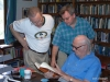 From R to L, Sir Arthur, DrFumblefinger, and Neil McAleer who wrote Arthur's biography. Discussing one of Arthur's books.