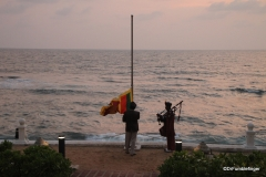 Flag-lower ceremony at sunset, Galle Face Hotel