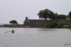 Fisherman and view of Batticaloa Fort across the Lagoon