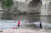 Teenagers fishing in the Vienne River, Chinon
