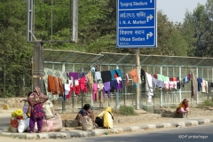 Delhi street scene. Doing the laundry