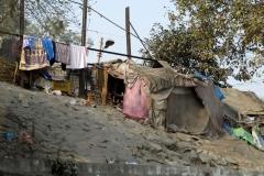 Delhi street scene. Squatter's shacks
