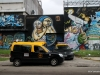 Street art in Colegiales, on power plant. Note the ubiquitous radio taxis