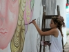 Artists creating street art on Charcarita walls.