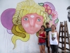The three artists working on creating this street art on Charcarita walls.