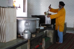 Volunteers preparing meal, Gurdwara Sis Ganj Sahib, Delhi