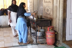 Volunteers preparing meal, Gurdwara Sis Ganj Sahib, Delhi
