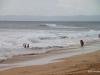 Surfers enjoying the surges as Hurricane Ana approaches Kauai's southern shore near Kekaha