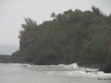 Tropical storm conditions existed, with rain and strong surf, Kalihiwai