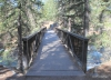 Bridge of Johnston Creek leading to the trailhead.