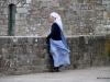 Nun enjoying view from terrace, Mont-St-Michel