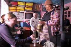 Being served butter tea in a Sherpa home