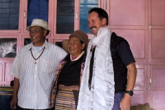 Frank and the Sherpa couple. The white shawl is made of silk and is a traditional gift
