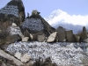 Mani stones, Khumbu region, Nepal. Framed by a massive snow-covered Himalayan peak