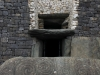 Entrance to the passage tomb of Newgrange. The upper window allows light to enter the tomb during the winter solstice