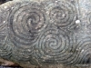 The triple swirl was of significance to these ancient people as it recurs at the site. No one knows why