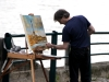 Artist painting Eiffel Tower viewed from Seine River