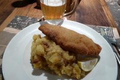 Schnitzel, with fried potatoes and onions