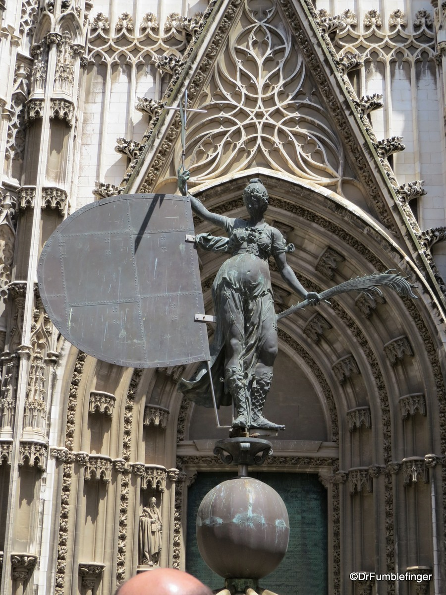 Copy of El Giraldillo, the weathervane of the Giralda, outside the main entrance to the Cathedral