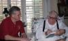Ray Bradbury signing books with Wayne Houser