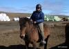 Sylvia riding an Icelandic horse