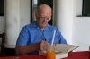 Sir Arthur, patiently signing one of the many books I'd brought to him at the Colombo Swim Club