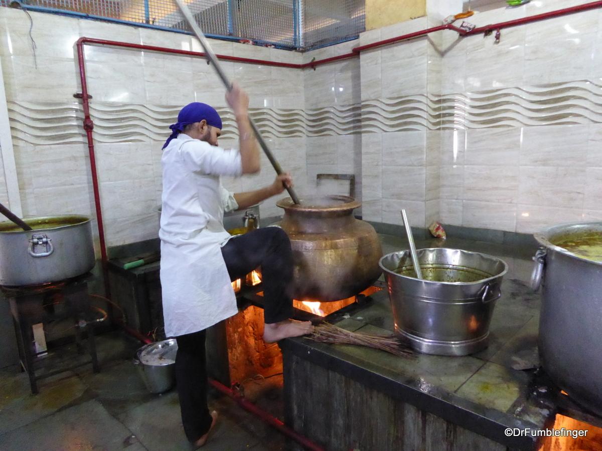Volunteers preparing the noon meal, Gurdwara Sis Ganj Sahib, Delhi