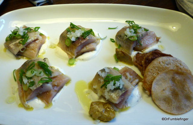 (matjes herring and boletes served with sour cream and buckwheat pancakes)
